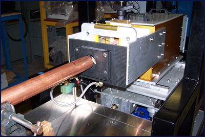 "This is a fully automatic system that anneals the 4"" length of each copper tube.  Tube size diameters range from 1"" to 4"". Process is designed for full automatic operation as the tubes are fed into the induction annealing system, quenched and then retracted away."